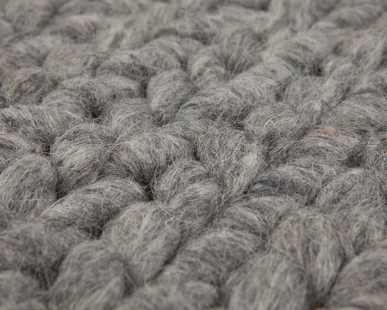 close up grey woolen carpet 1