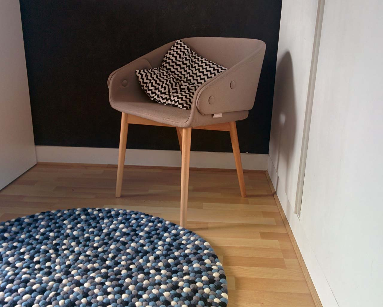 beige chair with beautiful cushion nepalese contemporary geometric rug