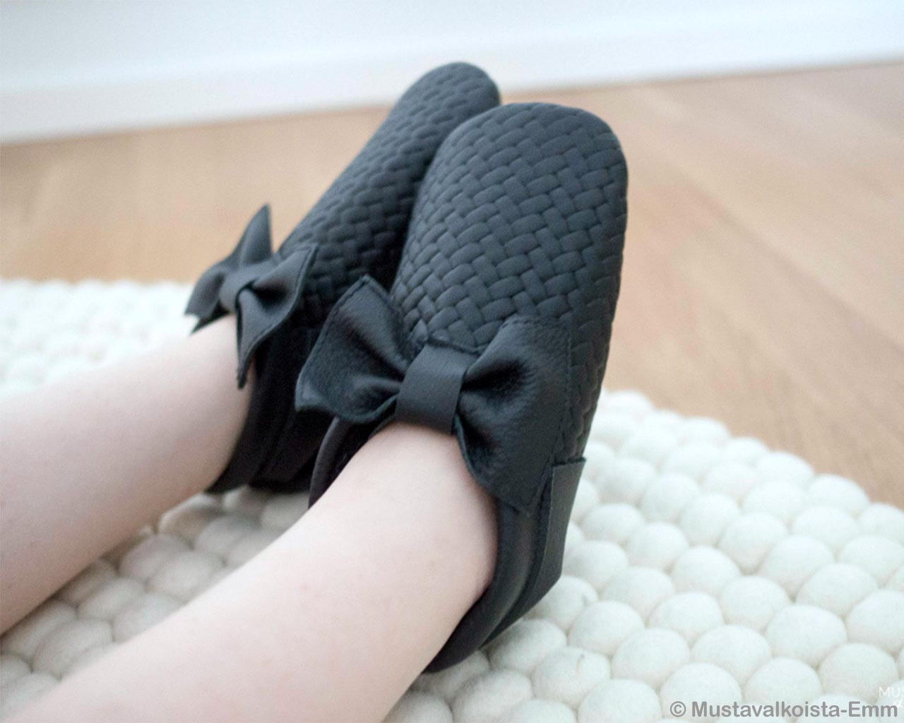 dark gray shoes in kids feet nepalese danish design rugs