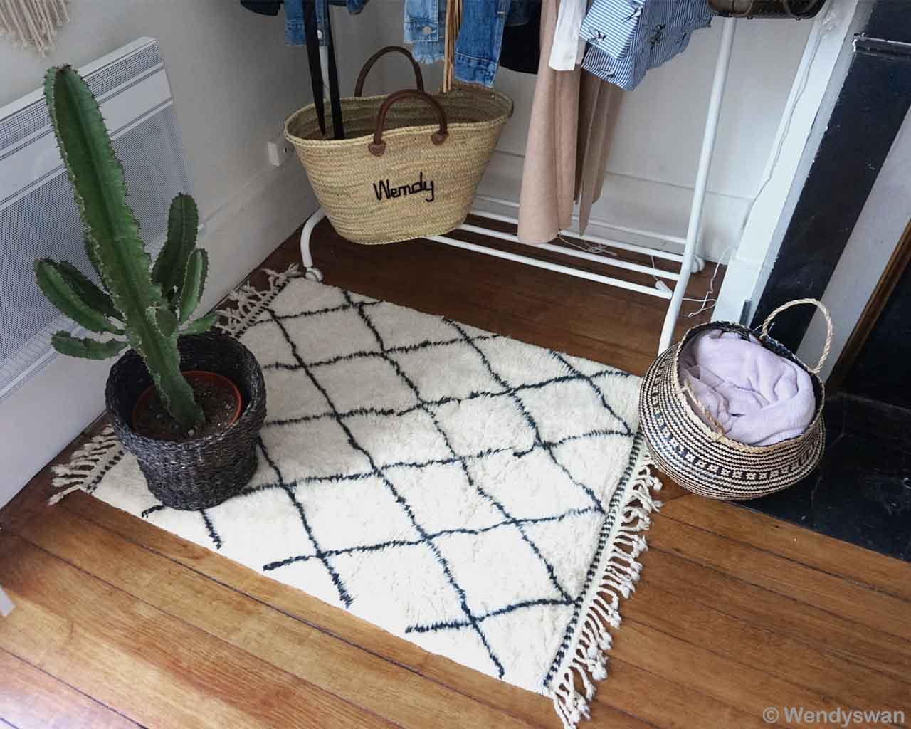 hand knotted basket by wendy and hanging clothes made in morocco carpet