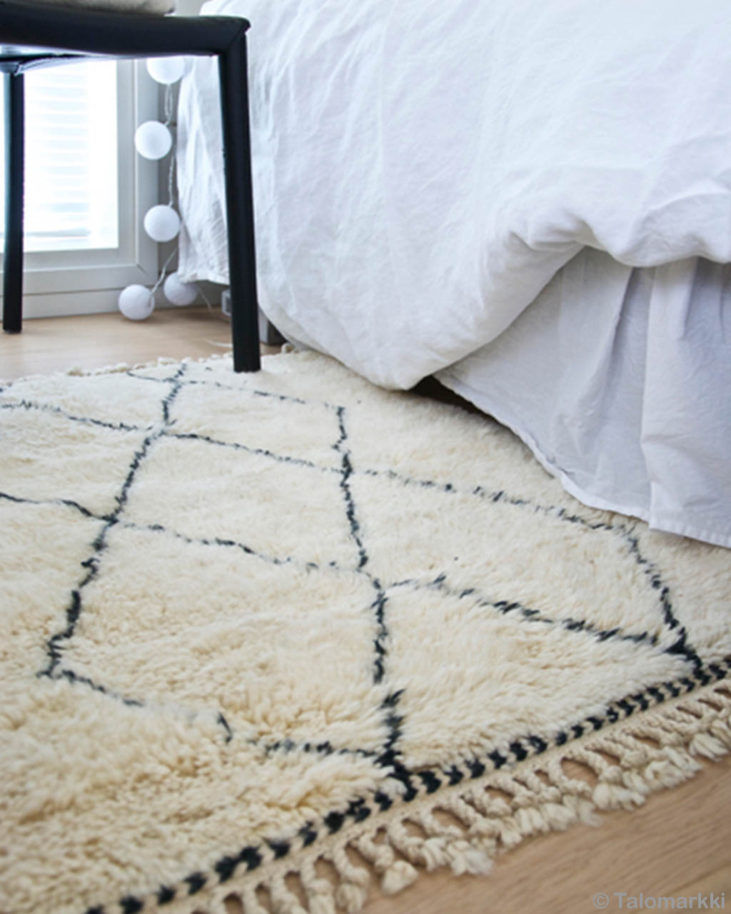 hand knotted bed with white bedsheet made in morocco fresh childrens rugs