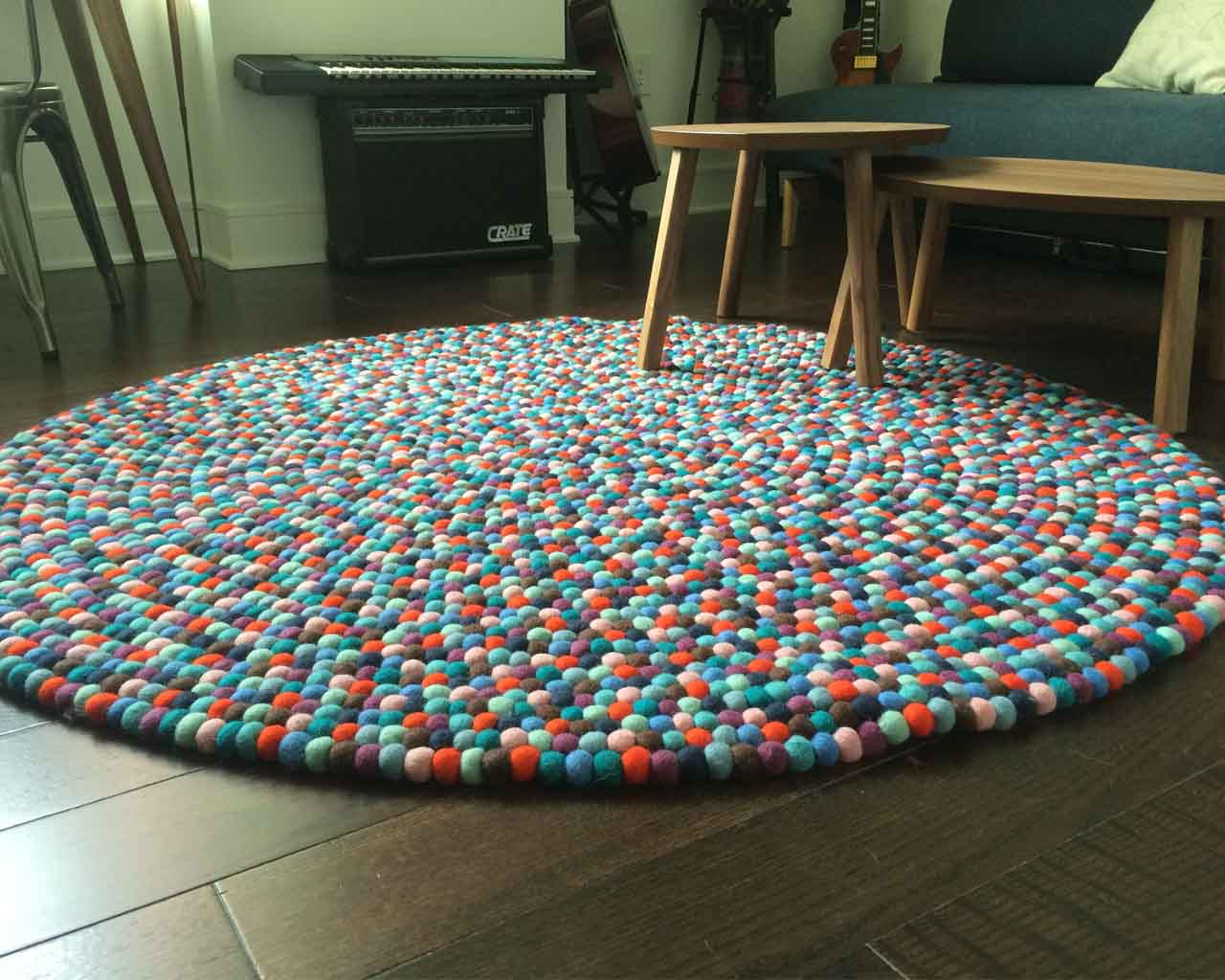 handmade round tables and piano made in nepal rugs