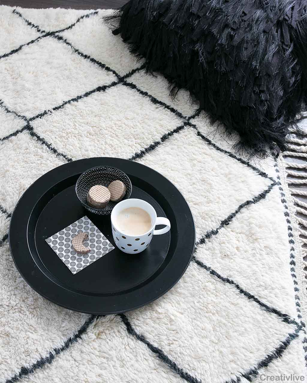 handmade tea cup and biscuits in black tray made in morocco contemporary floral rug