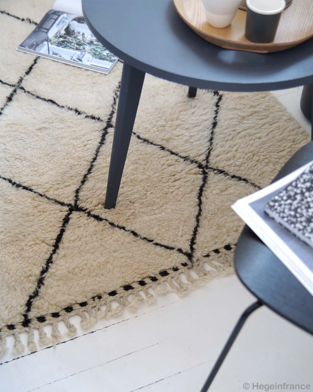 woolen center table and open book african modern beni ourain carpet