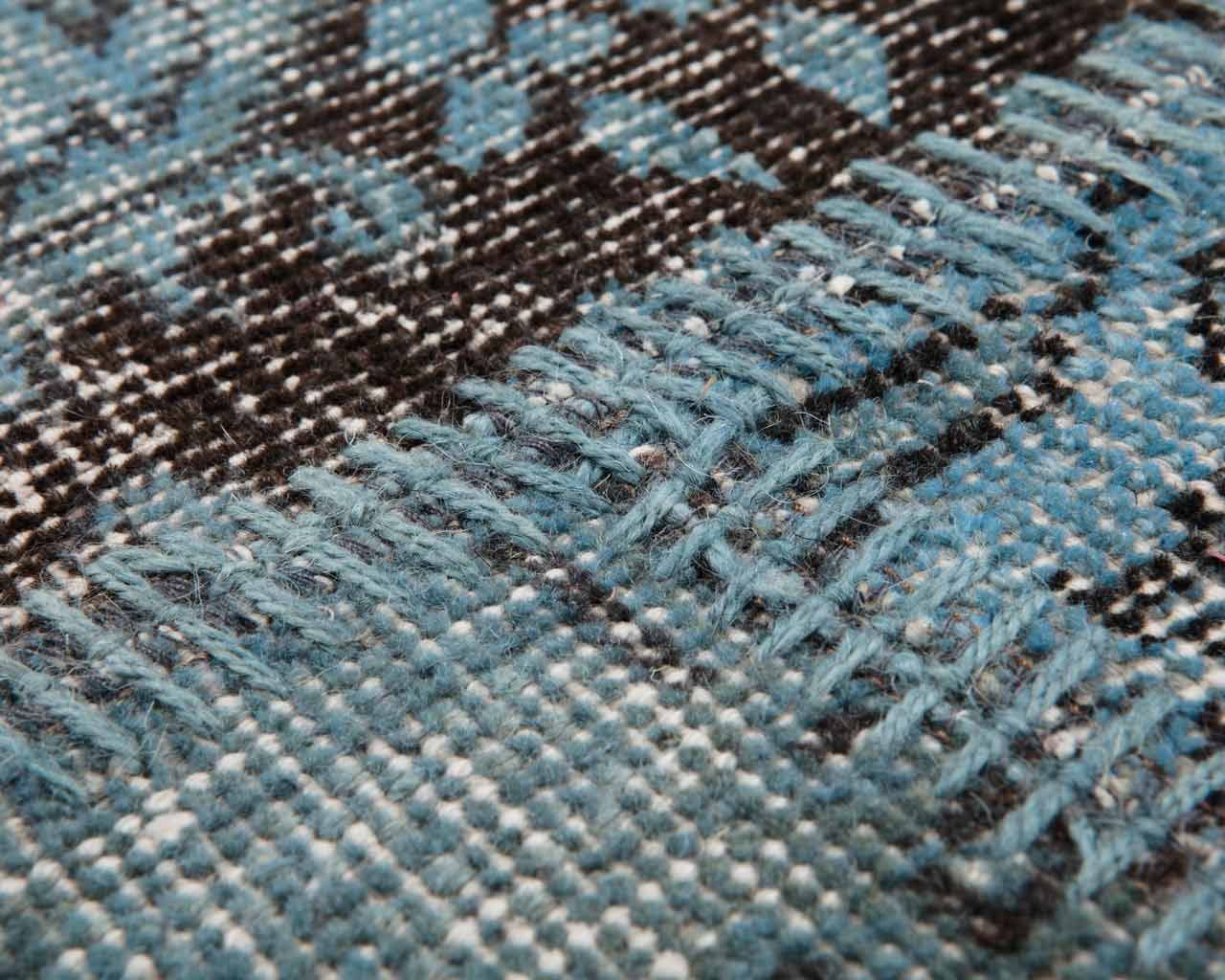 light blue patchwork overdyed rug